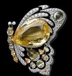 CARTIER-Broche papillion-diamants jaunes et blancs