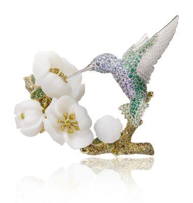 VAN ClEEF & ARPELS-or blanc-or jaunediamants de couleurs-saphirs de couleurs-émeraudes-opale blanche
